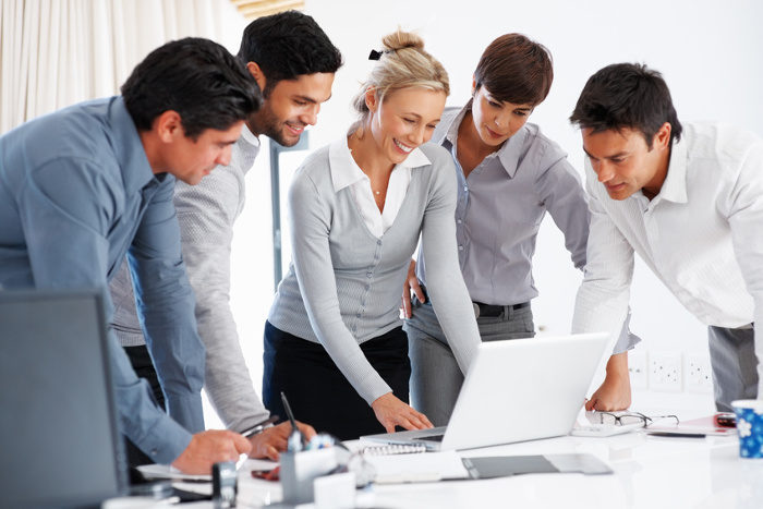 Group of successful business people working on laptop during meeting